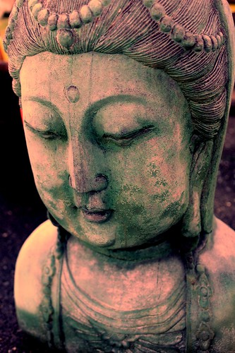 Chinese Bodhisattva bust, ornate hair style, concrete garden statue, Lake City Way, Seattle, Washington, USA by Wonderlane