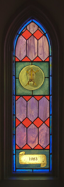 Saint Peter Roman Catholic Church, in Jefferson City, Missouri, USA - stained glass window of bishop's mitre, 1983