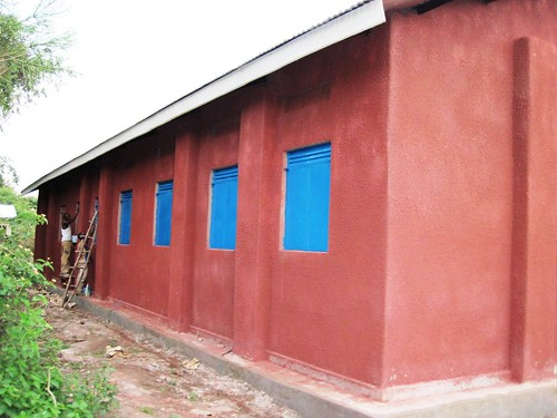 painting windows by Kasese Humanist Primary School