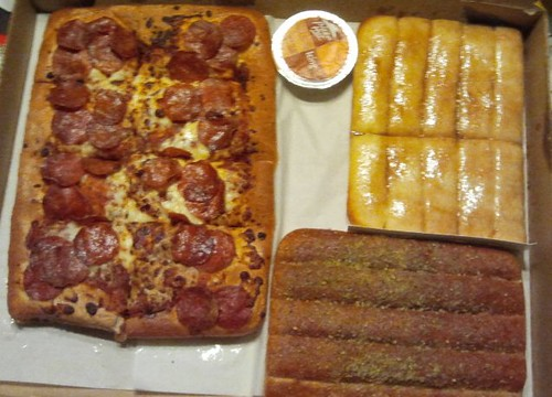 Pizza Hut's $10 Dinner Box includes one medium rectangular 1-topping pizza, 5 breadsticks with marinara dipping sauce, and 10 cinnamon sticks with icing – All in one convenient box. The medium pizza wasn't that big at all. Upon further inspection, we discovered that the pizza was actually made from 10 breadsticks, covered with sauce and.