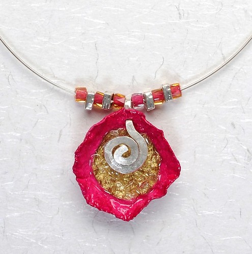 necklace made of paper pulp combined with beads
