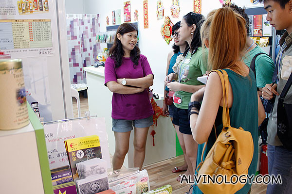 Bloggers interviewing the shop owner