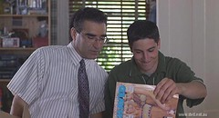 A scene from the movie American Pie where a father has an awkward sex talk with his son. The son holds a porn magazine