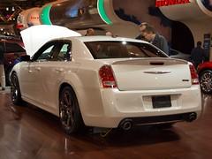 automobile(1.0), automotive exterior(1.0), exhibition(1.0), wheel(1.0), vehicle(1.0), automotive design(1.0), auto show(1.0), chrysler 300(1.0), chrysler(1.0), bumper(1.0), sedan(1.0), land vehicle(1.0), luxury vehicle(1.0),