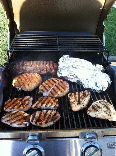 Grilled sirloin, pork chops, chicken and special recipe potatoes with onions (in foil).  Heather Luis, AMS Livestock and Seed Program, uses an infrared grill.  She says it sears the meats well and gives them good, juicy flavor. Photo courtesy Heather Luis