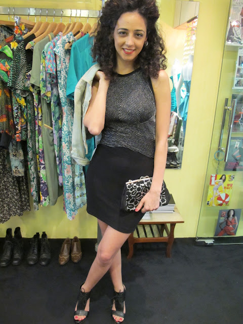 Off with that jacket! Vintage shimmery body-hugging dress and silver-floral purse from Granny's Day Out.