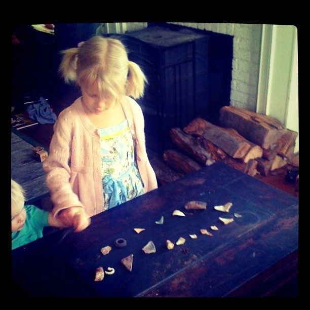 Archeologist Ella and her morning findings.