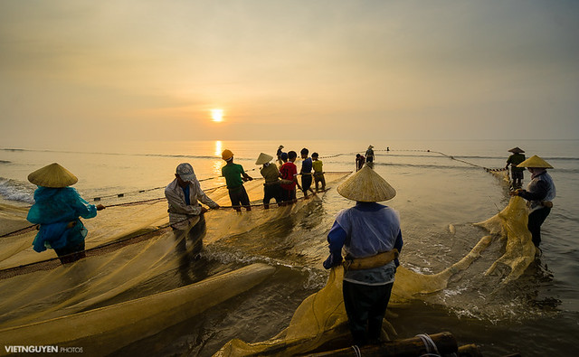 Traditional fishermen are pulling the seine (fishing net) from the sea