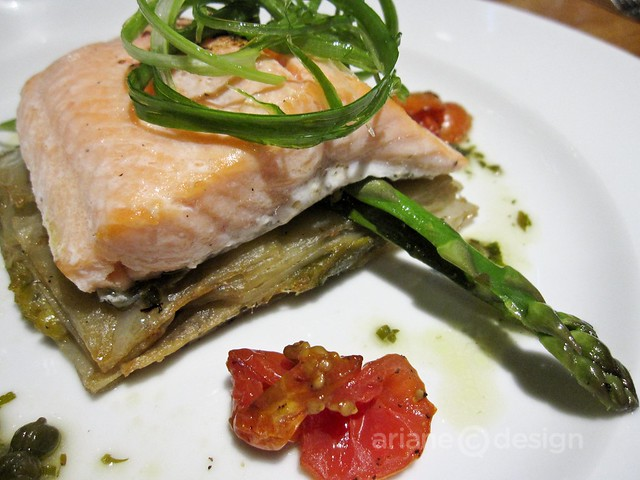 Salt and pepper seasoned steelhead, potato leek gratin, oven dried tomatoes and capers