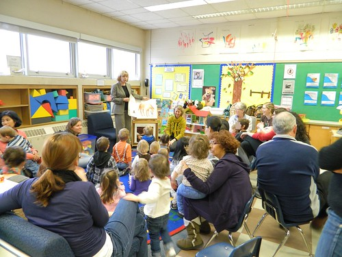 Cheri reads to children for Literacy Day 2012.