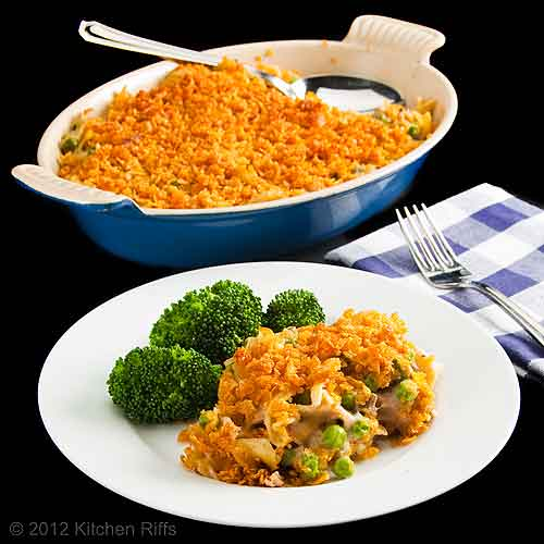 Tuna Noodle Casserole on plate with broccoli, casserole dish in background