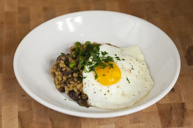 Wheat Berry Risotto with Mushrooms and Peas Topped with an Egg