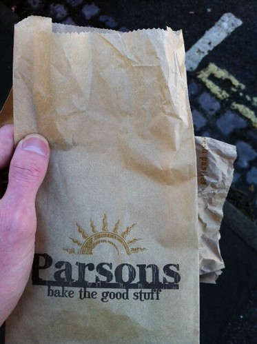 Eating a delicious sausage roll from the only place that sell them. This place: by benparkuk
