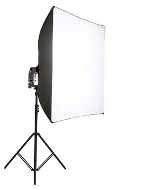 An assembled lightbox and off-camera flash on a stand.