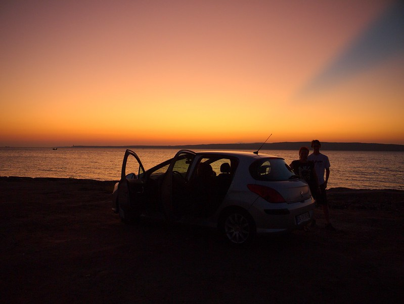 Our car and its passengers in sunset light