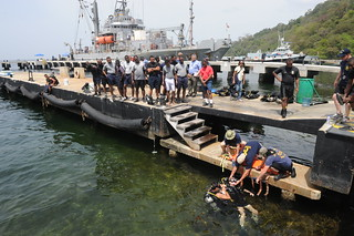 U.S. Navy divers demonstrate an unconscious diver drill to Trinidad and Tobago divers.