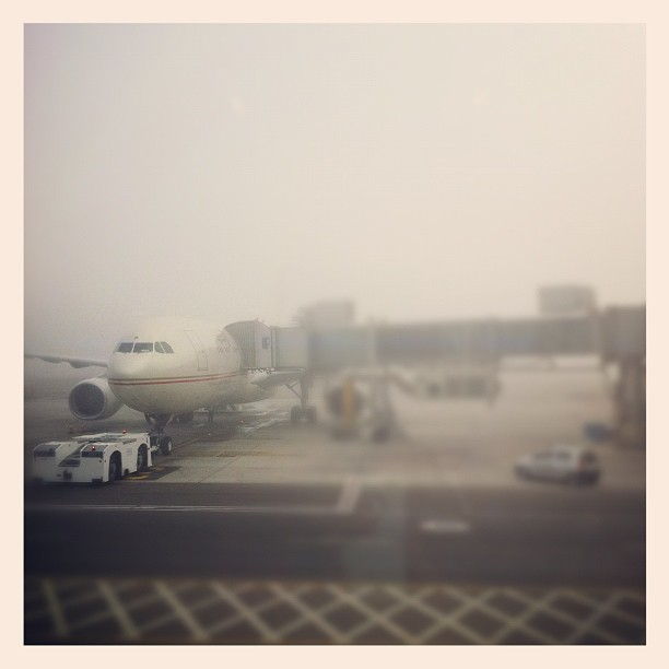In foggy Abu Dhabi waiting to be able to board our flight to JFK.