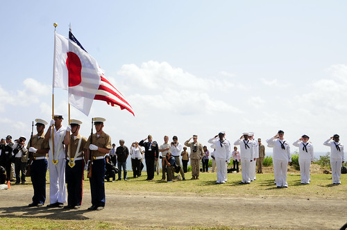Sailors from USS Germantown render honors as the honor guard parade the colors during the Reunion of Honor Ceremony.