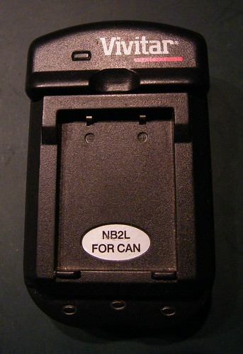 Vivitar charger for Canon NB2L lithium battery - front case