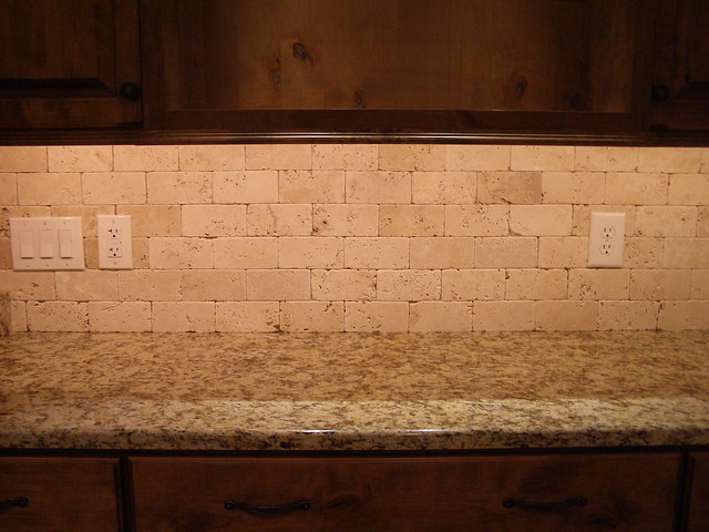 Ivory tumbled travertine without grout flickr photo for Tile backsplash without grout
