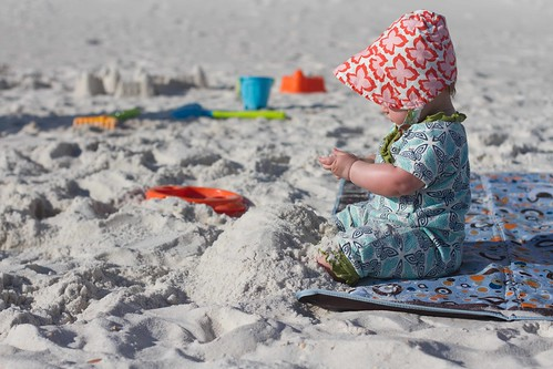 baby buried in the sand.