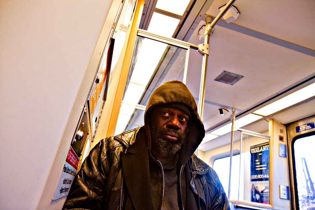 Hooded-man-on-El-on-2-13-12--West-Philly
