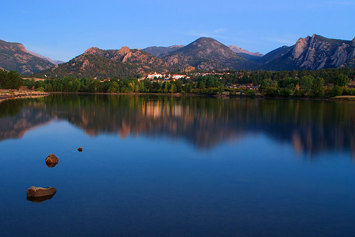 morning blue sky lake mountains color reflection water rock america sunrise buildings landscape rockies outdoors dawn town nationalpark cool scenery colorado view unitedstates dynamic hill calming calm historic timeexposure alpine valley jagged rockymountains serene peaks hillside estespark drama slope rugged rockymountainnationalpark tranquilscene stanleyhotel worldrenowned lakescenics