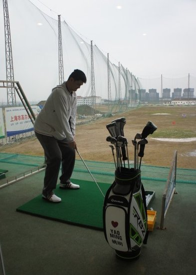 March 9th, 2012 - Yao Ming practices hitting golf balls at a Shanghai driving range