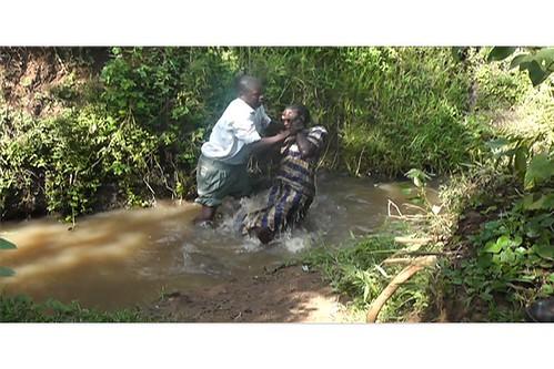 Outreach Ministry Preacher Alphaeus Okeyo baptizes Zippaa Mokeira