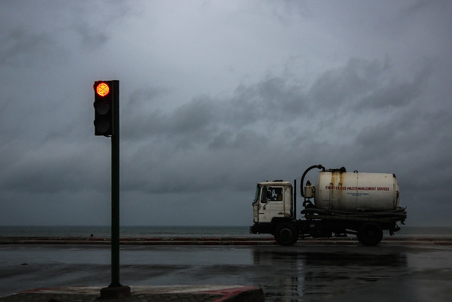 Stop Light, Septic Truck & the Sea