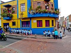 Small Children Crossing the Street in Bogota