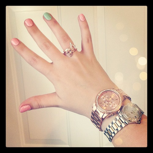 Rose gold and silver rings and watches