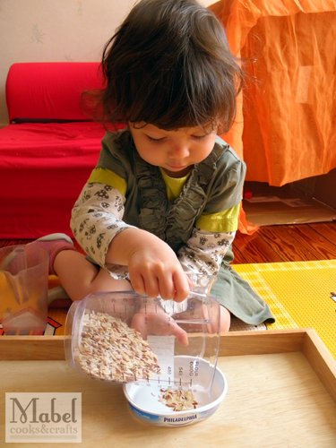 Montessori life skills: Pouring into a smaller container