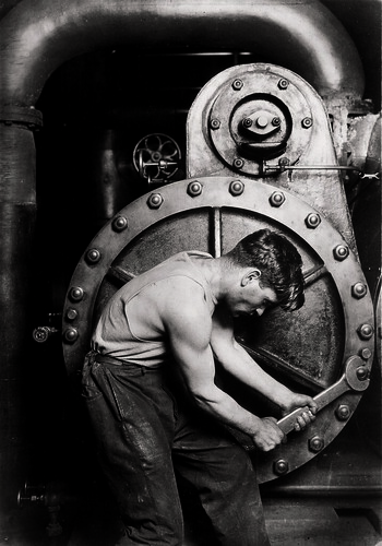 Mechanic at steam pump in Electric power house., 1920