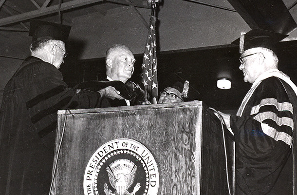 <p>President Dwight D. Eisenhower is given his hood as part of an honorary doctoral degree from Board of Regents chair Philip E. Spalding and vice chair Fred K. Lam, M.D., on June 24, 1960, as UH president Laurence H. Snyder looks on.</p>