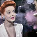 Actor Paul Heinried Blows Pink Smoke Toward Movie Star Bette Davis…