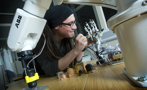 Micro-engineering on a robot hand at the BRL