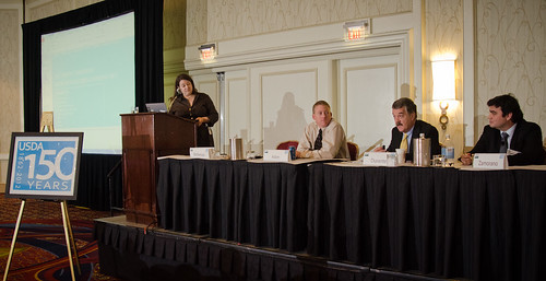 "Agriculture Senior Advisor to the Secretary and session moderator Sarah Bittleman (left), refers a question to Clean Fuels Development Coalition Executive Director Douglas Durante (second from right), during the Renewable Energy session on ""Moving Renewable Energy Forward,"" at the 2012 Agricultural Outlook Forum"