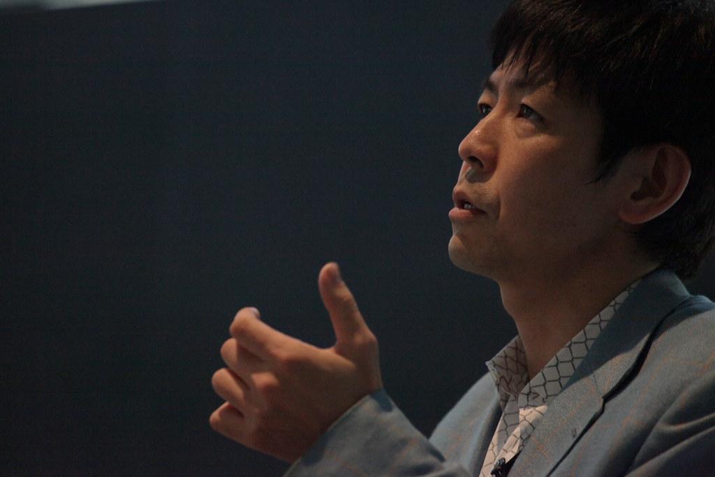 Yoshiharu Tsukamoto presenting.