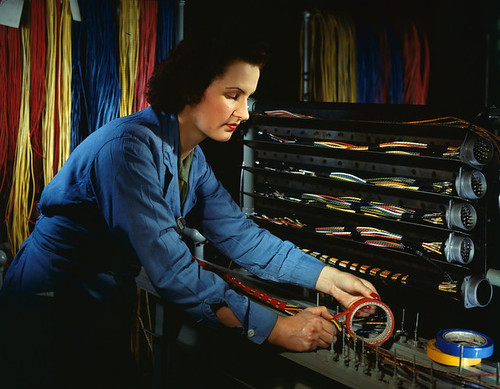 [Woman taping wire, Chrysler Corporation]