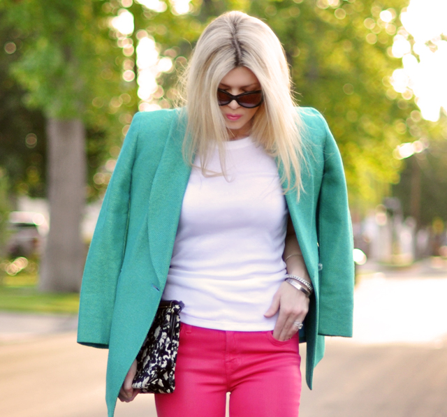 wearing brights - bright pink jeans- teal blazer-black and white bag
