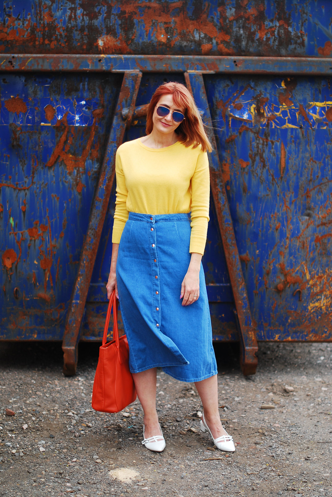 Primary brights colour blocking: Yellow sweater, denim midi skirt, orange tote bag, white pointed flats | Not Dressed As Lamb