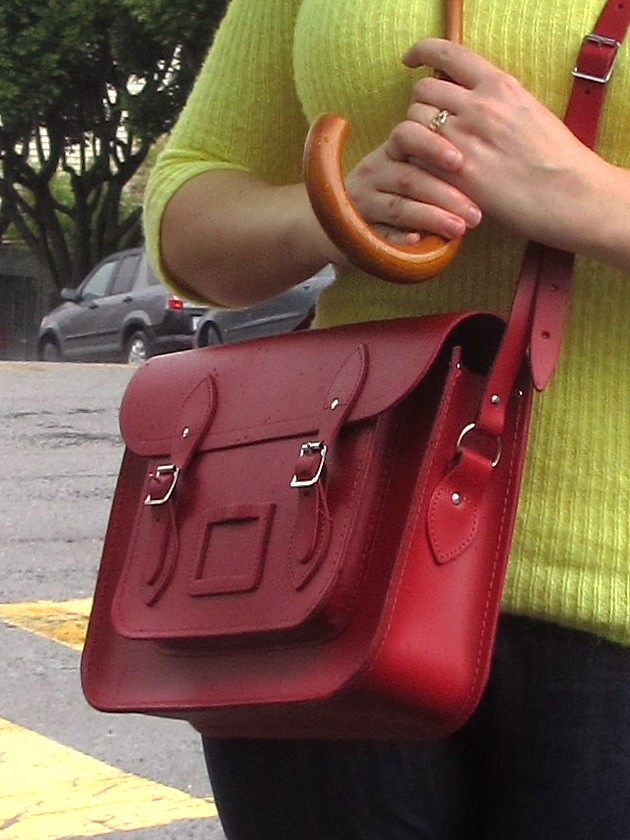 Color blocking with a red Cambridge Satchel, yellow sweater, and blue jeans. (Photo by Pat Zimmerman.)