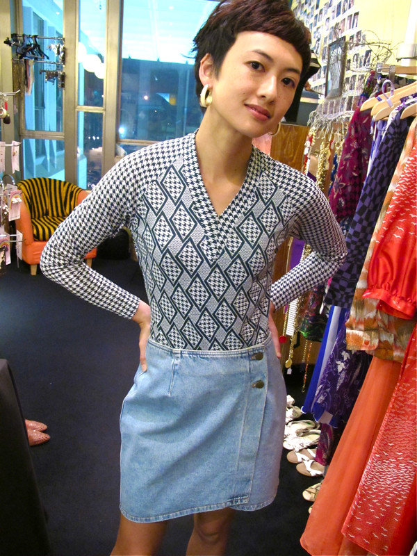 1970s printed bodysuit, paired with a 1980s Donna Karan denim skirt and enamel earrings