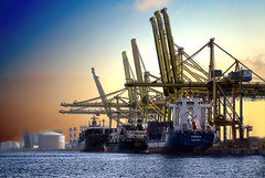 jackup rig(0.0), offshore drilling(0.0), oil rig(0.0), port(1.0), crane vessel (floating)(1.0), vehicle(1.0), transport(1.0), freight transport(1.0), petroleum(1.0), industry(1.0), harbor(1.0), construction equipment(1.0), watercraft(1.0), container ship(1.0), oil field(1.0),