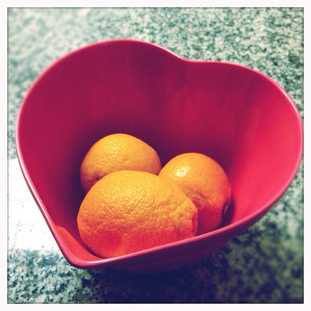 Oranges in my heart bowl.