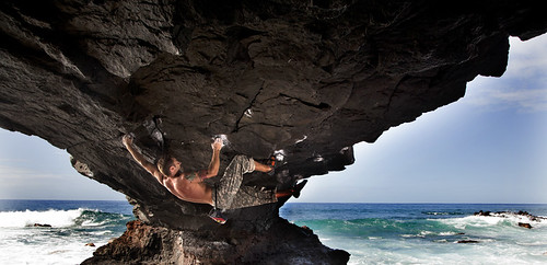 Justin Ridgely dances under the Arch, Oahu, Hawaii.