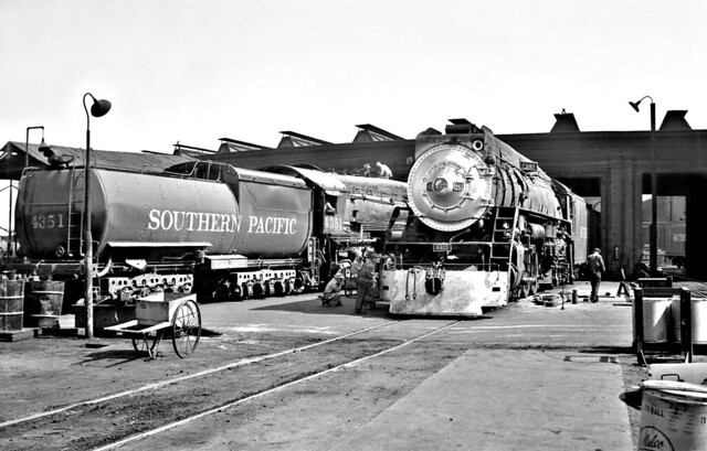 Southern Pacific Alhambra Roundhouse is seen with passenger type steam locomotives in Los Angeles, California, late 40's or early 50's