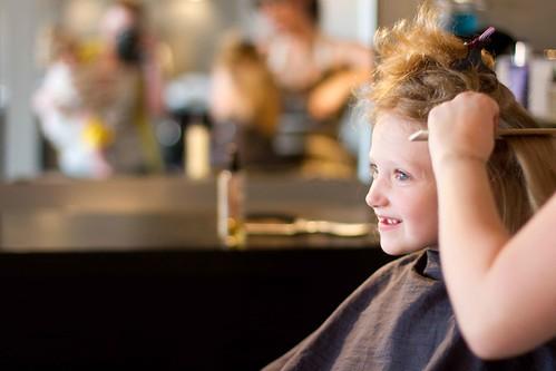 Addie getting a haircut.