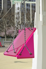 purple(0.0), handbag(0.0), outdoor play equipment(1.0), swing(1.0), pink(1.0),